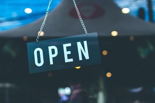 "Selective focus photography of ""OPEN"" sign on glass door. Photo by Artem Beliaikin on Pexels"