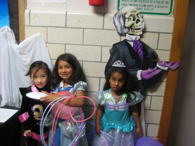 Three Young Girls in Halloween Costumes