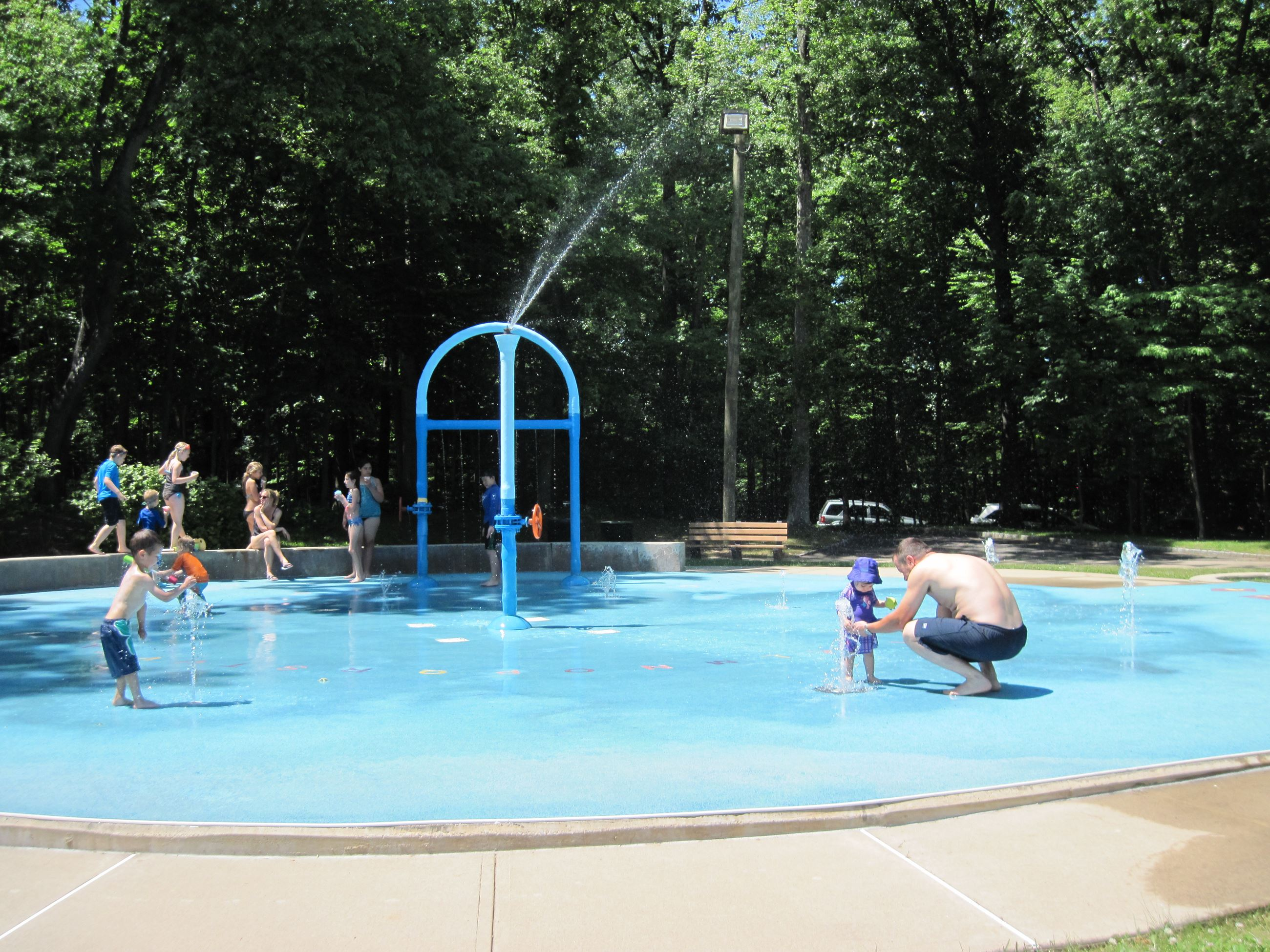 Kids and Parents Playing on a Splash Pad
