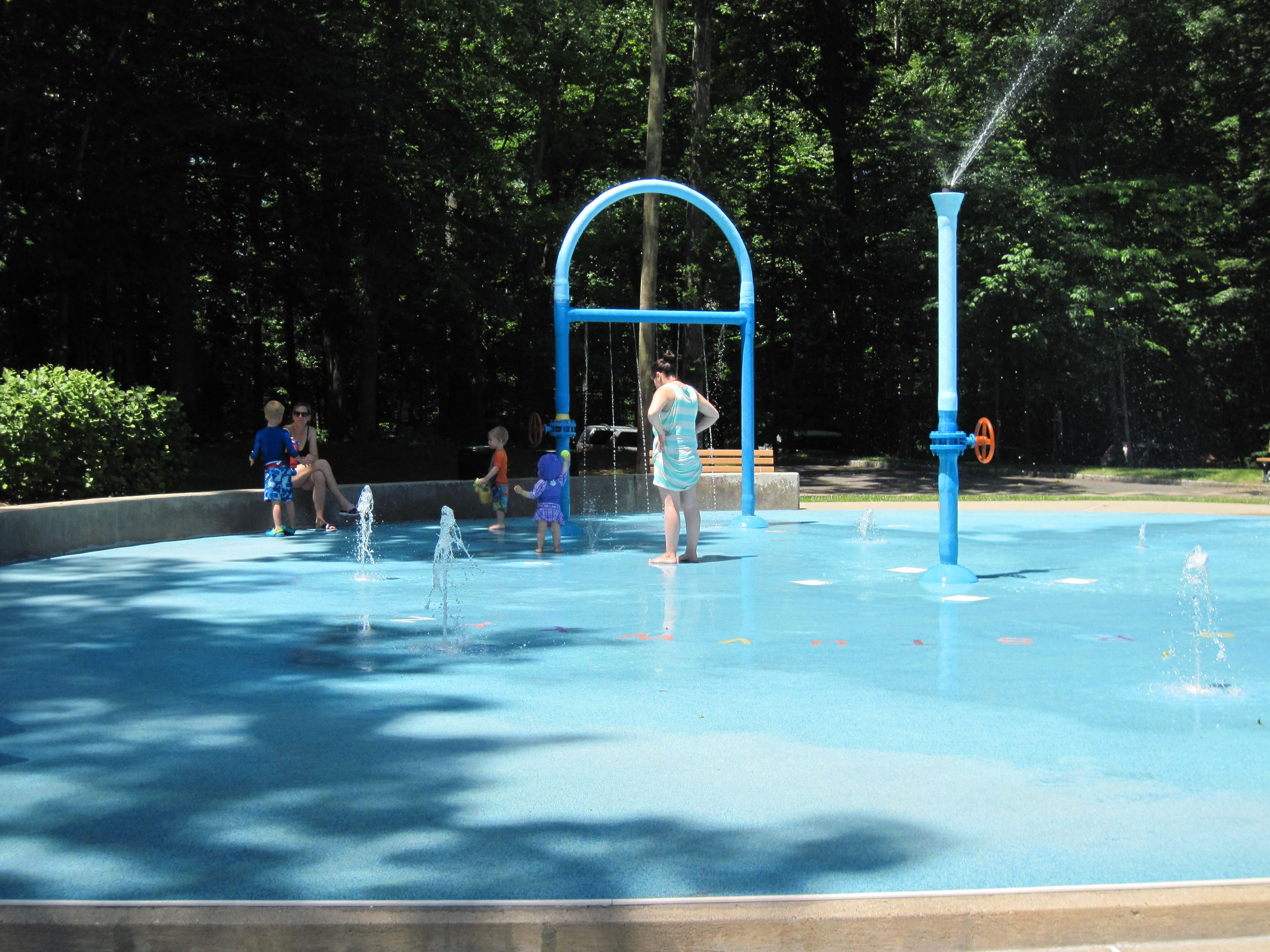 Parents and Children Playing on a Splash Pad