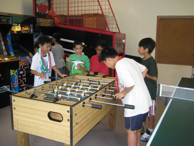 Kids Playing Foosball