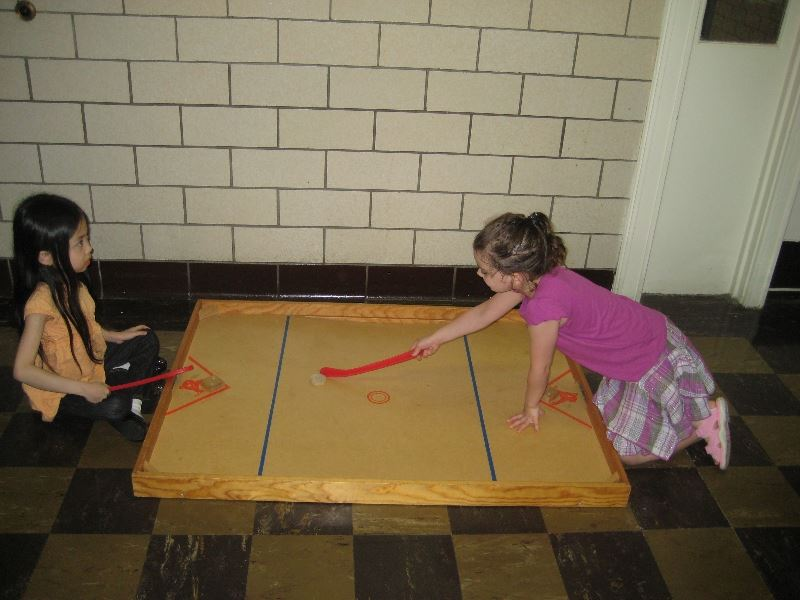 Girls Playing a Hockey Game