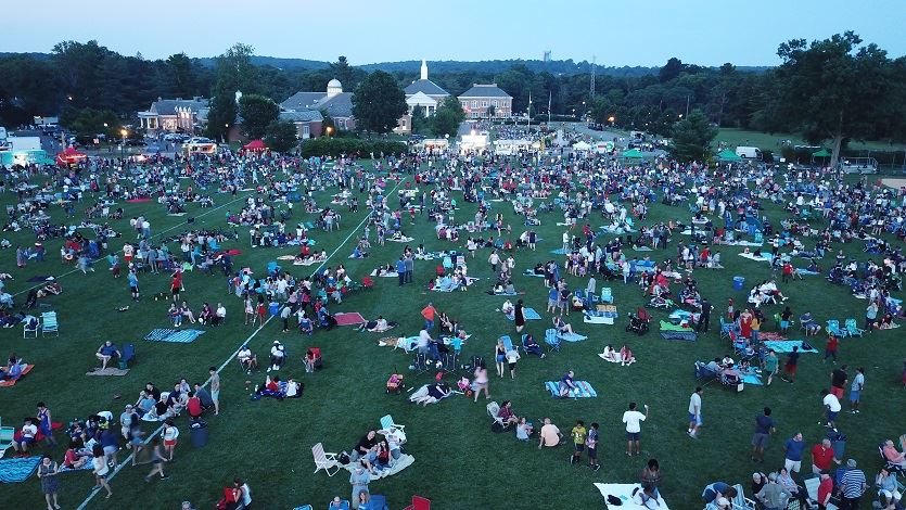 Aerial photo of crowd gathering before fireworks, with Library and Town Hall in background