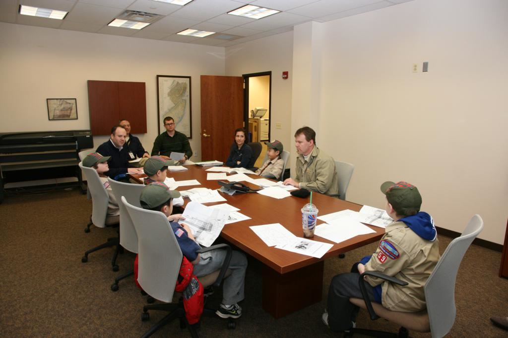 Boy Scouts Sitting at a Conference Table
