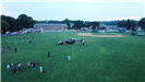 Drone photo of Oval with helicopter and families, and fire truck in background