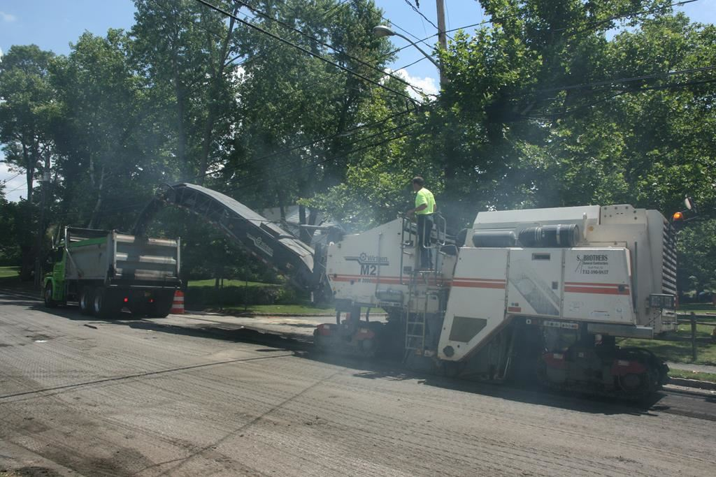 Machine Putting Asphalt into a Truck