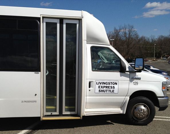 Photo of the Livingston Express Shuttle - side view of front of shuttle with doors and sign