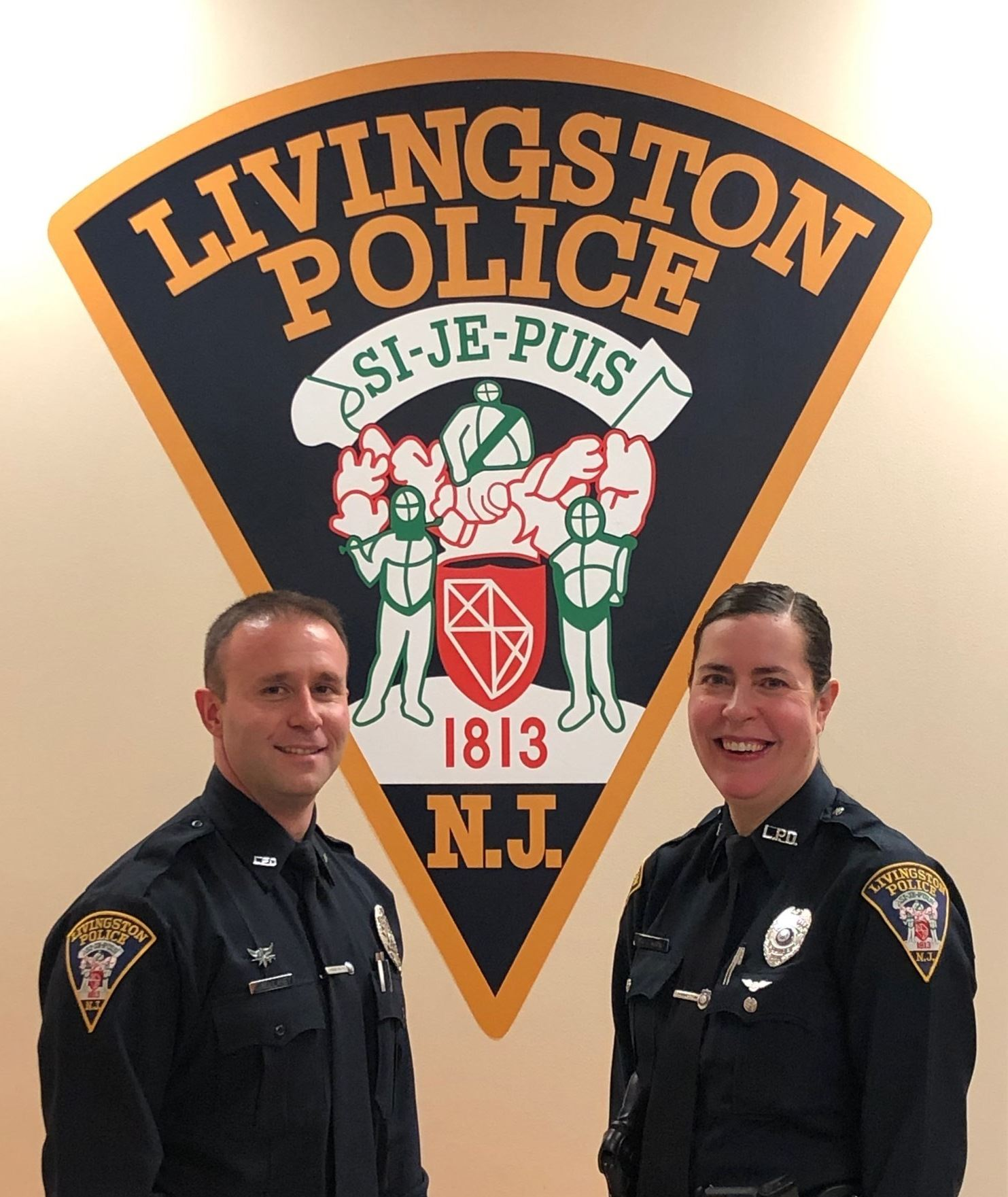 Two police officers smiling
