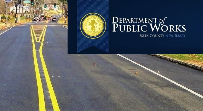 Essex County Department of Public Works logo over photo of paved county road with construction vehic
