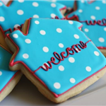 Blue house-shaped cookies with white polka dots and