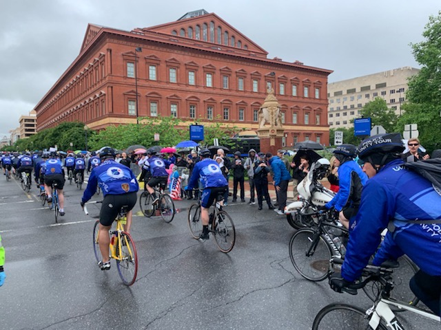 Photo of large group of officers riding bikes, riding in the Police Unity Tour
